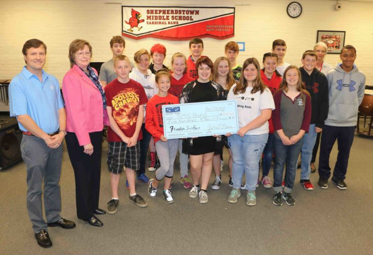 """Members of Shepherdstown Middle School Jazz Band receive a check from """"The Friends of Music."""" (Submitted photo)"""