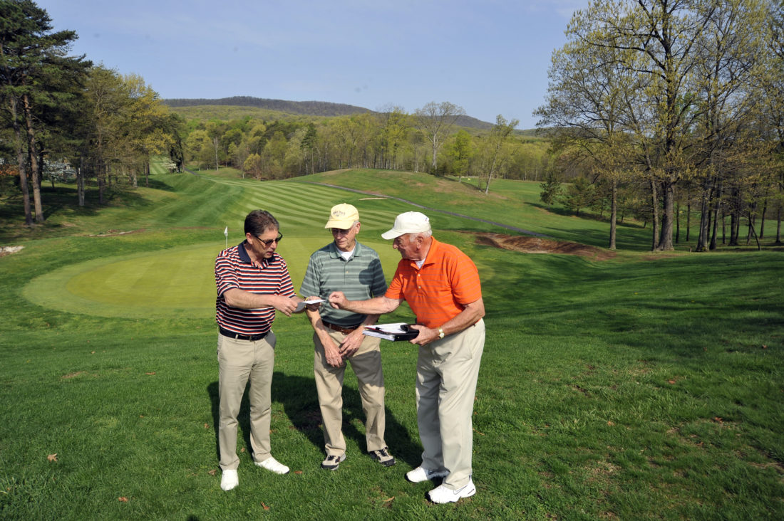 Shown, from left, are golf pro Ron Springer, Meals on Wheels board member Frank Ceravalo and vice president Jim Reed planning the biggest annual fundraiser for Meals on Wheels at The Woods Resort Golf Course. (Journal photo by Jeff McCoy)