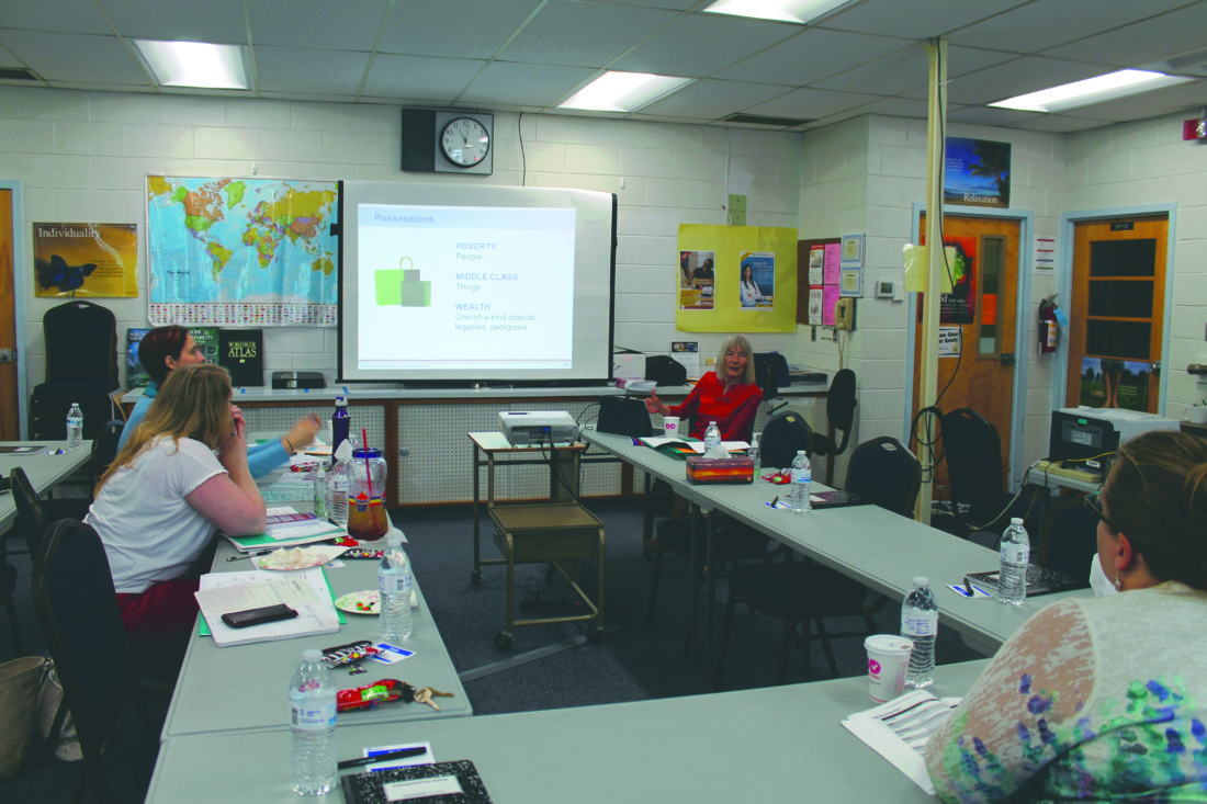 (Journal photo by Danyel VanReenen) Shalom Tazwell, Literacy West Virginia regional assistant, instructs local instructors during a framework for understanding poverty workshop based on Ruby K. Payne's book at James Rumsey Technical Institute on Friday.