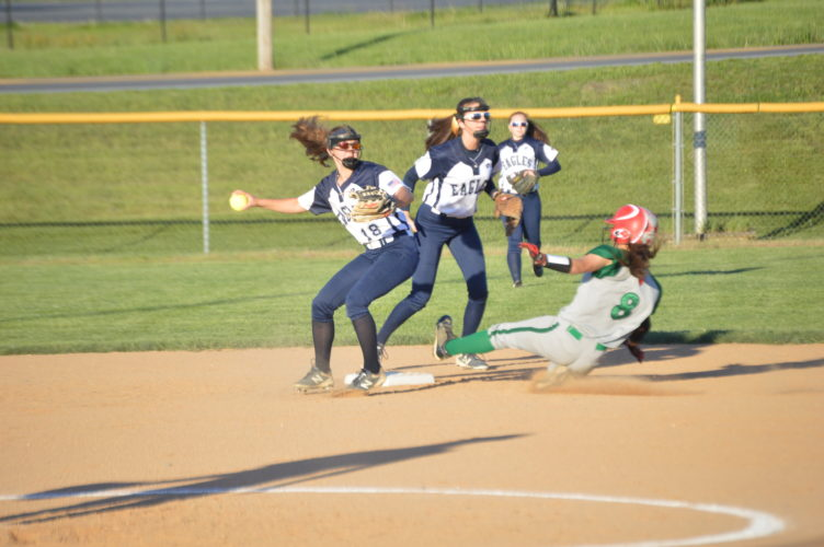 Hedgesville shortstop Isabella Forte, left, prepares to throw to first after retiring Musselman's Tierra Locke on a force play during Wednesday's Class AAA, Region II, Section 1 game at Hedgesville. (Journal photo by Jessica Manuel)