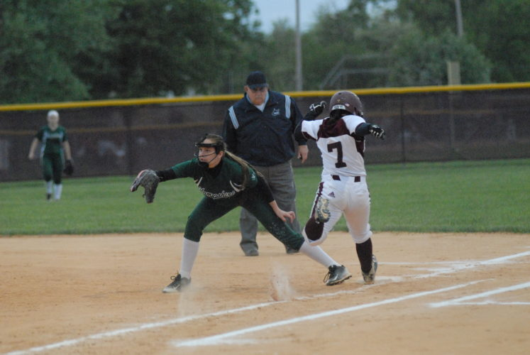 Jefferson's Izzy O'Bannion tries to beat out the throw to first during Thursday's Class AAA, Region II, Section 2 elimination game. Jefferson picked up a 9-1 victory over Hampshire to continue in the postseason.