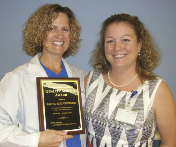 WVU Medicine Jefferson Medical Center's Quality Service Award winner for the first quarter 2017 is pictured receiving her award.  Rachel Sigel-Domenico, on left, is shown with Marney Treese, MD,  medical director of the emergency department. (Submitted photo)