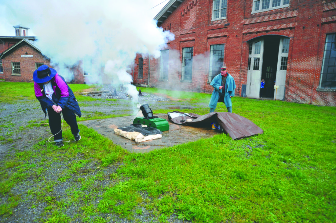 Journal photos by Jeff McCoy Berkeley County Councilwoman Elaine Mauck fires a cannon at the 2nd Annual Gen Jackson Great Train Raid in Martinsburg as Cpl. Robert Lohr calls the shot.