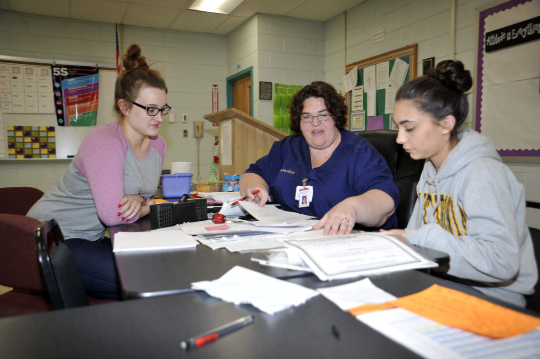 From left, student Clara Bardour, Therapeutic Services Instructor and HOSA Adviser Kenya Starcher and student Mary Bailey make plans for the International Competition that is being held in Orlando, Florida in June.