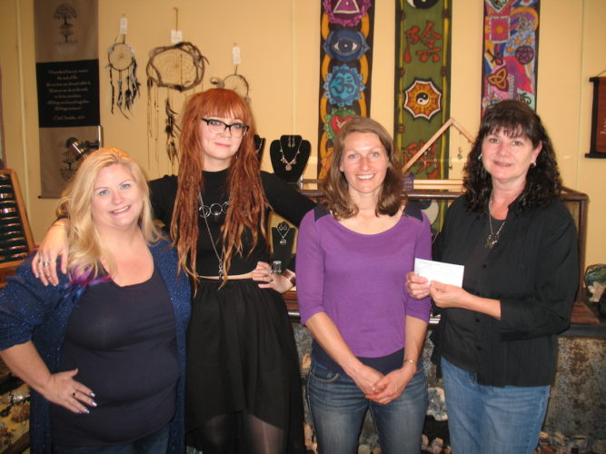 This year's donation was presented at the shop on May 10. The accompanying photo shows, from left to right, shop employees Margie Florimbio and Stephanie Blakley, Potomac Valley Audubon Society Land Manager Bridget Tinsley, and shop owner Laura Rau. (Submitted photo)