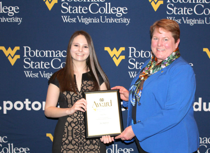 (Submitted photo) Ali Barrett, left, of Hedgesville, was named the 'E. William Noland Outstanding Student' at WVU Potomac State College. Campus President Jennifer Orlikoff, Ph.D., presented the award.