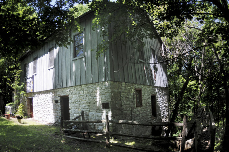 The Thomas Shepherd's Grist Mill Erected before 1739 on the original land grant from Lt. Gov. William Gooch and the Virginia Council  Oct 3, 1734. The overshot Water Wheel, 40 feet in diameter is the largest in the world. (Journal photo by Ron Agnir)