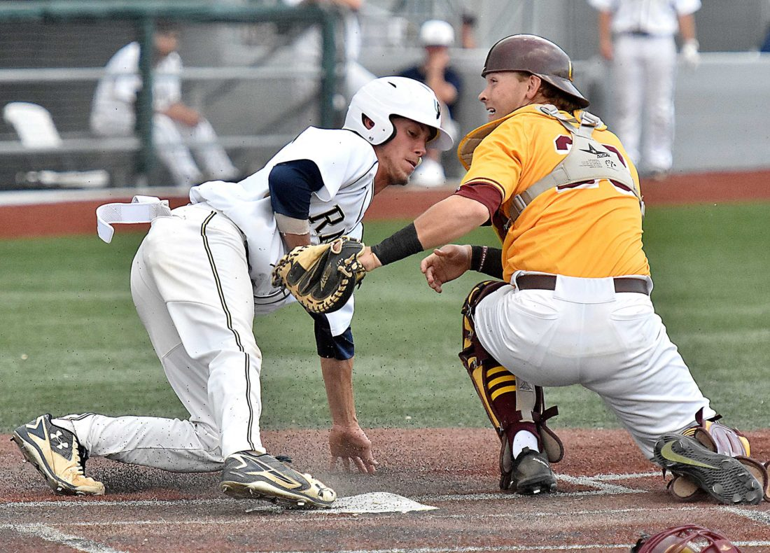Photo by Brad Davis/The Register-Herald Shepherd's Trenton Burgreen, left, looks to avoid the tag from Charleston's Steven Davis as he tries to score on a wild pitch during the Mountain East Conference title game on Sunday.