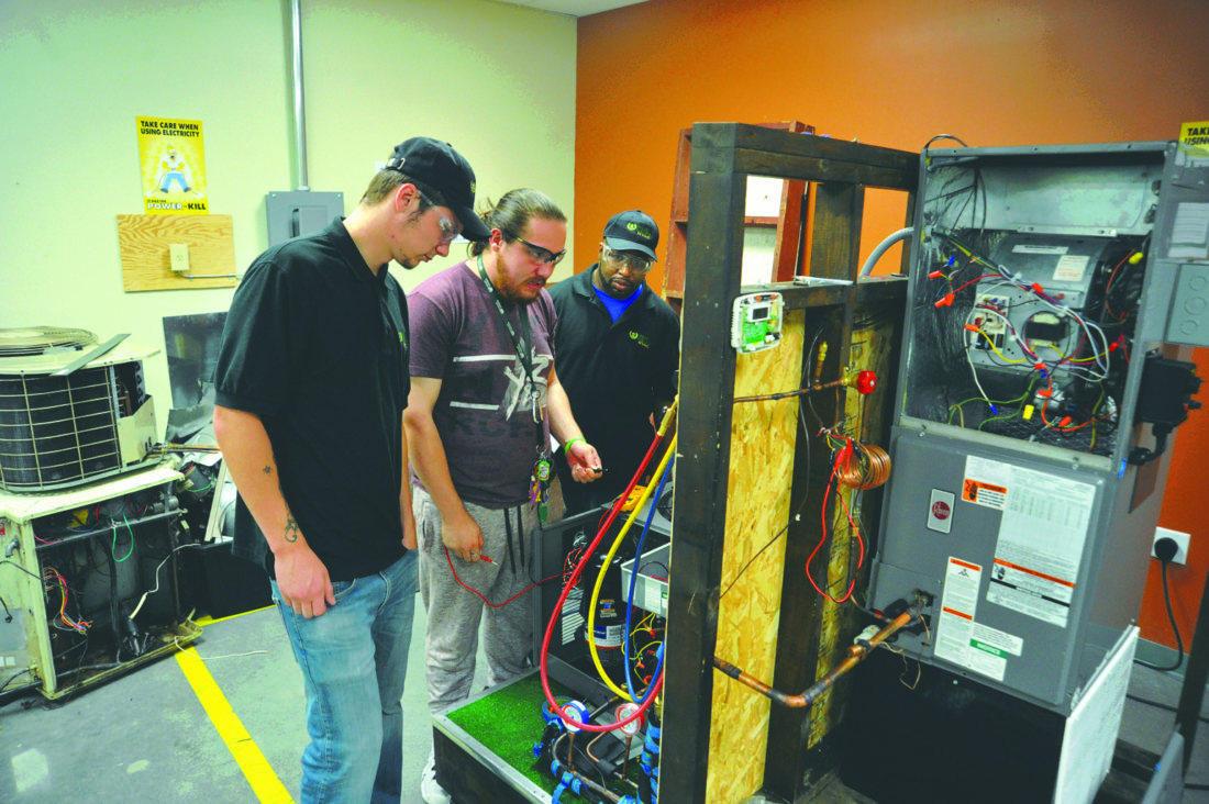 Journal photo by Jeff McCoy Pictured, from left, are Valley College HVAC students Dennis Lewis, Damon Delars and Robert Winbley as they work to repair a unit in the lab at the Martinsburg campus.