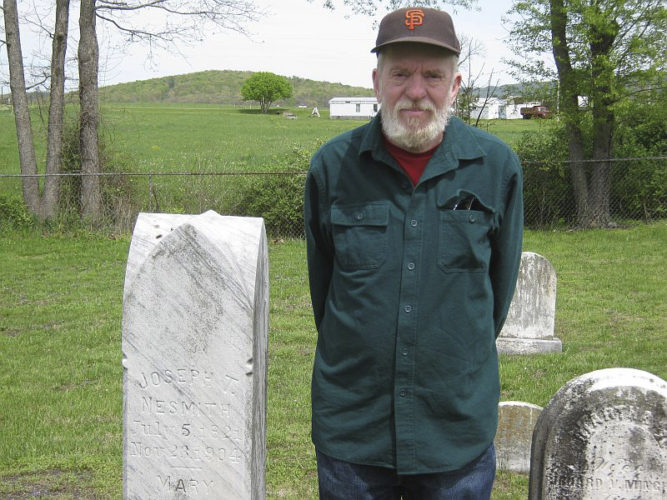 Submitted photo Stephen Willingham at the graves of his great-great-grandparents in Back Valley, Berkeley County.  Their names were Joseph and Mary Nesmith and they were married in Berkeley Springs on Christmas Eve in the late 1840's.