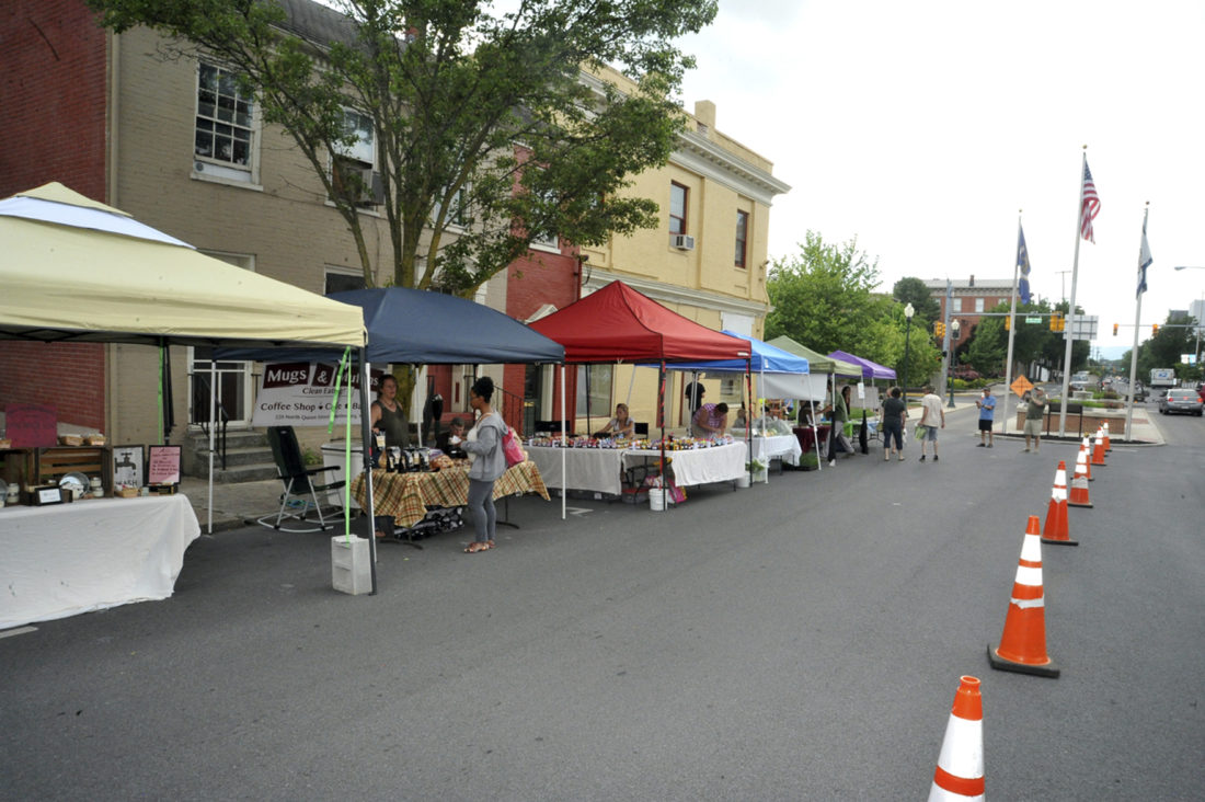 Journal photo by Jeff McCoy The farmers market opened for the season on Friday on the square in downtown Martinsburg.