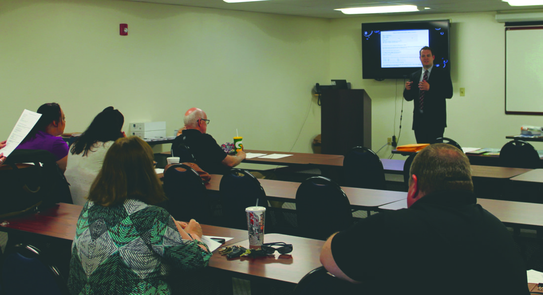 Journal photo by Danyel VanReenen Brandon Vallee, public information officer of Jefferson County Homeland Security and Emergency Management, presents volunteers with information Thursday to prepare them for upcoming Disaster Ready Kids programs in Jefferson County.
