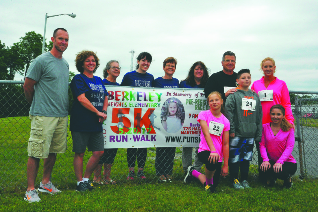 (Journal photo by Jeff McCoy) From left, Berkeley Heights Elementary School Vice-Principal Chad Pence, Principal Amber Boeckmann, Classroom aid Joyce Bower teacher Emma Holland, classroom aid June Yurish, Classroom aid Kristin Douty, Emma Rader's sister Sarah, Emma's father Mark, brother Ryan, mother Julia and sister Kaitlyn, pose before the 5K race which was held in honor of Emma Rader on Saturday in Martinsburg.