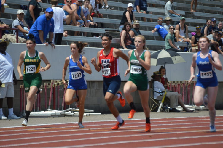 Washington's Roxanne McFarlin (third from left) and Musselman's Eva Pisano (right) race during the girls Class AAA 100-meter dash on Saturday at the state track meet. Pisano finished second and McFarlin fourth. (Journal photo by Jessica Manuel)