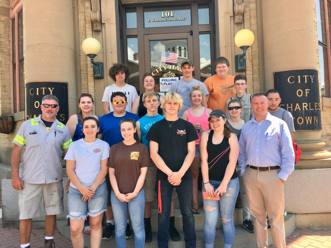 Students enrolled in greenhouse and horticulture classes with interim City of Charles Town manager Todd Wilt, far right, and city employee Jim Wysong, left.