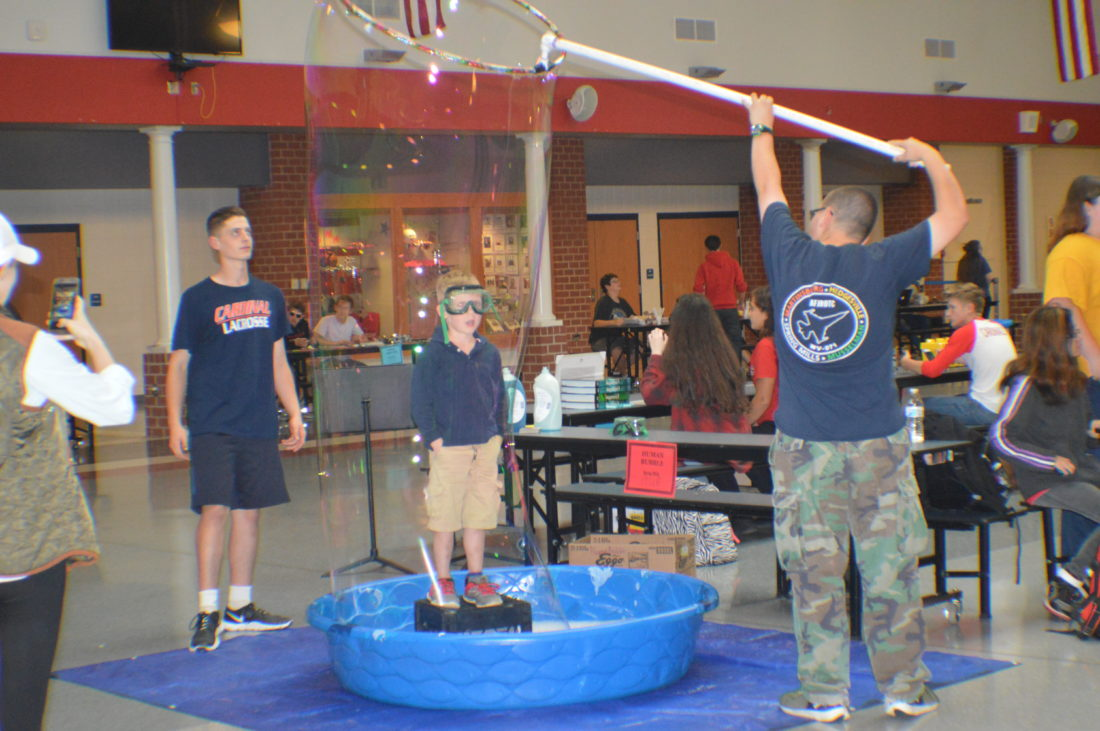 Participant is shown at one of the interactive stations on STEAM night. (Journal photo by Adranisha Stephens)