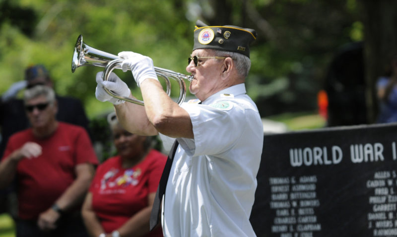 Kenneth Yeakley, Veterans Combined Honor Guard, plays TAPS at the Memorial Day Ceremony at War Memorial Park in Martinsburg in 2016. (Journal Photo by Ron Agnir)
