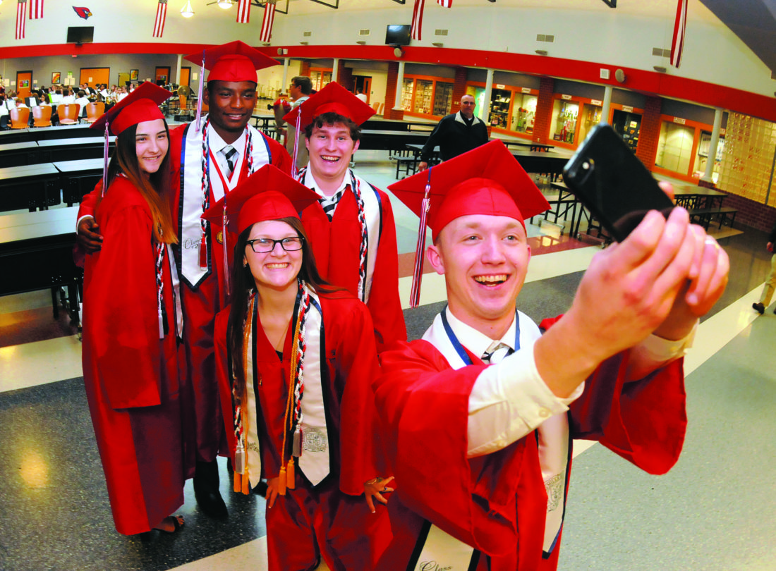 Journal photo by Ron Agnir Spring Mills graduating senior Jonathan Lease, front, takes a photo with classmates Brittany Shumaker, Justin Kemp, Chelsea Latham and Taylor Manross on Thursday evening at Spring Mills High School following graduation ceremonies.