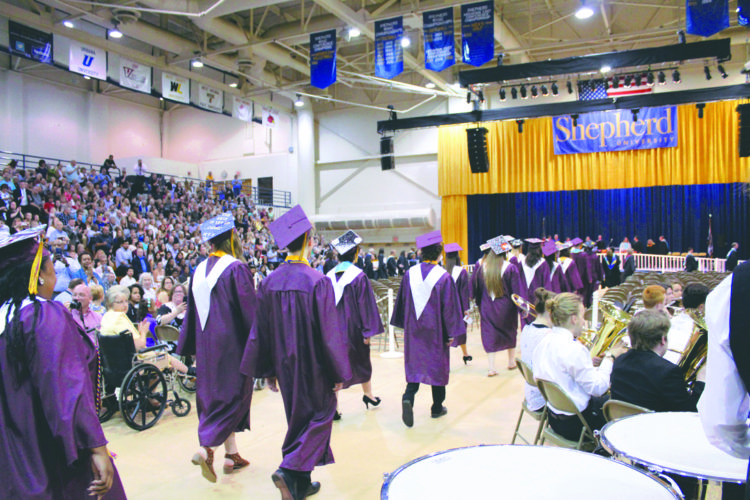 Submitted photo Jefferson High School seniors walk in during Saturday's ceremony at Shepherd University.