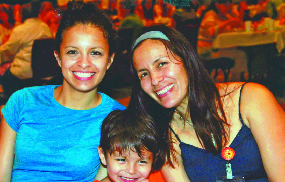 Submitted photos Oliver Nathan-Dugan, center, a local child who died in a vehicle accident in April. He is pictured with his mother Paloma, left, and his grandmother Lorena. A memorial service will be held Saturday.