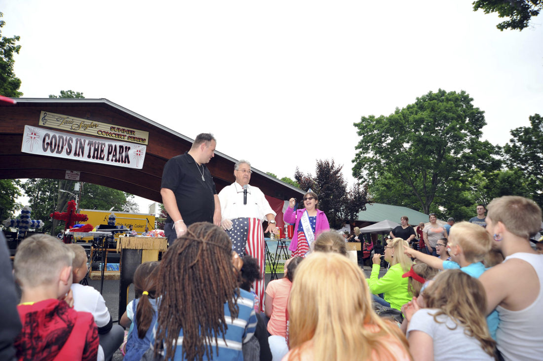 """Journal photos by Jeff McCoy Magician Michael T. Myers keeps the crowd entertained during a magic show at the third annual """"God's in the Park"""" event on Saturday at War Memorial Park in Martinsburg."""