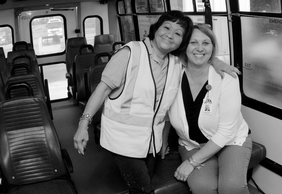 Journal photos by Ron Agnir Rosa Brown, EPTA Driver and Elaine Bartoldson, Deputy Director in an 18 passanger bus.