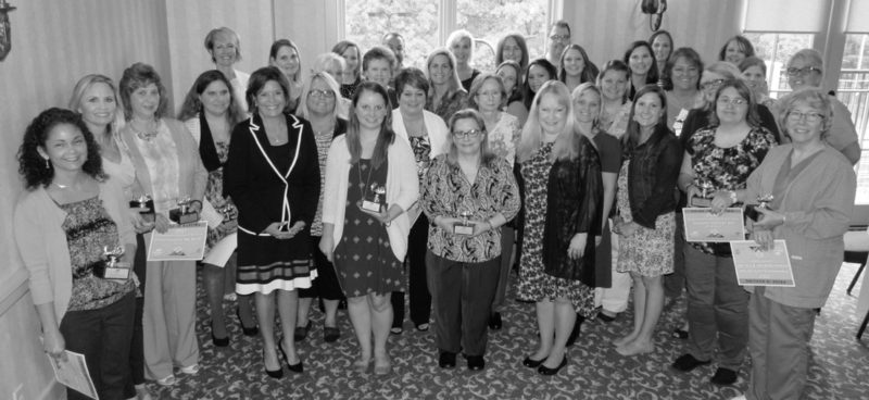 Right: For the group photo, Melanie Heuston, D.N.P., RN, chief nursing officer, fifth from the left, posed with the department nurses of the year, including: Jennifer Clark, RN, Joints; Judith Davis, B.S.N., RN, IV Infusion Center; Kelly Footen, B.S.N., RNC, Special Care Nursery; Sheila Frankenfield, B.S.N., RN, Cardiac Rehab; Denise Graham, RN, Emergency Department; Denise Harman, B.S.N., RN, Operating Room; Jennifer Hoover, RN, Float Pool; Denise Hudson, RN-BC, Ortho/Neuro/Trauma; Rebecca Kirkpatrick, B.S.N., RN, OCN, John R. Marsh Cancer Center; Deborah Lehr, B.A., RN, CCRN, CRN, Interventional Radiology; Amy Miller, B.S.N., RN, CCRN, Critical Care; Lois Mummert, M.B.A., B.S.N., RN, Pre-Procedure Evaluation; Heather Near, RN, Same Day Services; Stephanie Ocker, B.S.N., RN-BC, Behavioral Health; Misha Palladino, B.S.N., RN-BC, Women's and Children's; Valerie Pensinger, B.S.N., RN, Wound Center; Samantha Pereschuk, B.S.N., RN, PCCN, Home Health; Jane Real, B.S.N., RN, ONC, Medical/Surgical; Lynn Reed, RN, Post Anesthesia Care Unit; Cynthia Repp, RN, Outpatient Observation Center; Kelly Robinson, RN, Medical/Surgical/Intermediate Care; Steven Rotz, RN, Cardiac Cath Lab; Ronnie Schmidt, B.S.N., RN, Meritus Medical Group; Elisabeth Sharpe, B.S.N., RN, Rehabilitation; Andrea Sprecher, B.S.N., RN, School Health; Lauren Thomas, B.S.N., RN, Labor, Delivery, Recovery, Postpartum; Julie Wagner, RN, ACM, Outpatient Care Management; Clara Weibley, RN, Ambulatory Services; Susanne Winslow, B.S.N., RN, Oncology, Urology, Renal, Palliative Care; Wendy Youman, B.S.N., RN, Inpatient Care Management