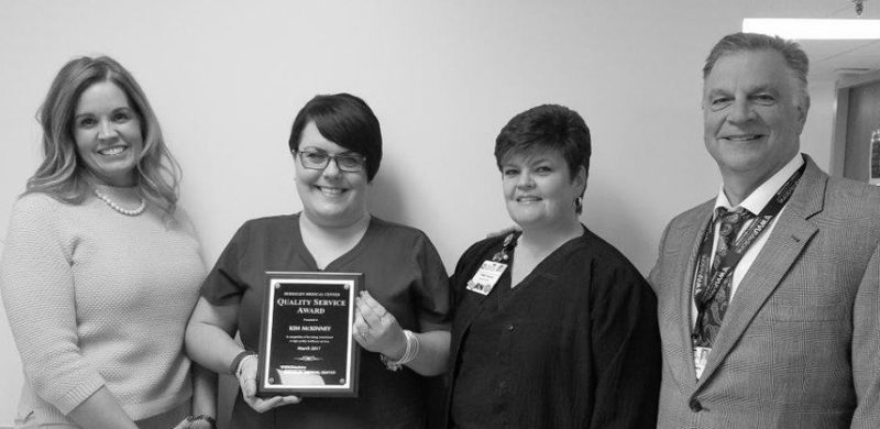 Submitted photo WVU Medicine Berkeley Medical Center's March Quality Service Award winner is pictured receiving her award.  Shown, from left, are  Samantha Richards, vice president and chief nursing officer; QSA Winner Kim McKinney, RN; Tammy Mason, medical/surgical nurse director; and Anthony P. Zelenka, president and chief executive officer.