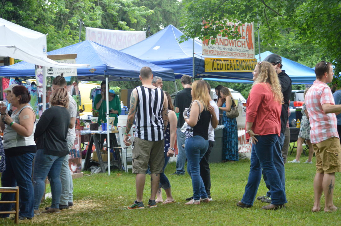 Wine and Arts Festival patrons explore the many vendors on the grounds of historic Boydville in Martinsburg on Sunday.