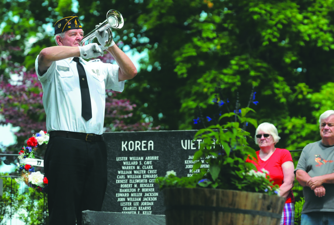 Journal photos by Ron Agnir Kenneth Yeakley, Veterans Combined Honor Guard bugler, performs Taps during the Memorial Day program hosted by VFW Post 896 at War Memorial Park in Martinsburg on Monday morning.