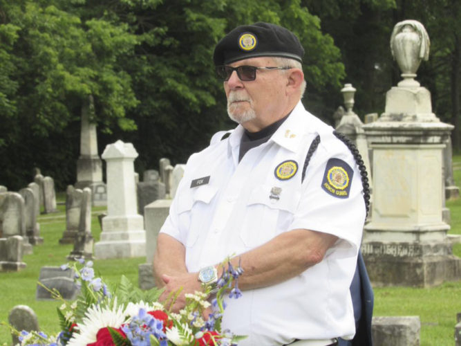 Journal photo by Toni Milbourne Ralph Fox, 10th District Commander, American Legion, challenged attendees at Edge Hill Cemetery to remember those who gave their all for their country.