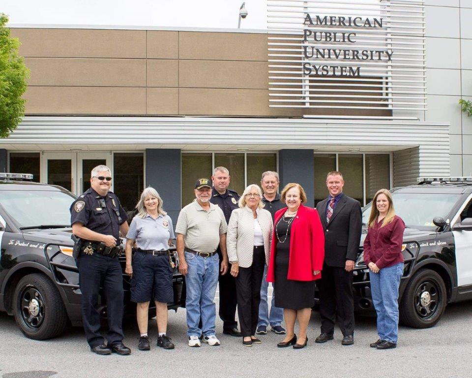 Pictured at the new headquarters are Capt. Glenn Stevens, Parking Enforcement Officer Shirley Slebodnick, Council Member Chet Hines, Chief Kutcher, Mayor Smith, city Building Commission Chair Bill Warren, American Public University System President Karan Powell, Interim City Manager Todd Wilt and city police department Administrative Assistant Amanda Gerstell. (Submitted photo)