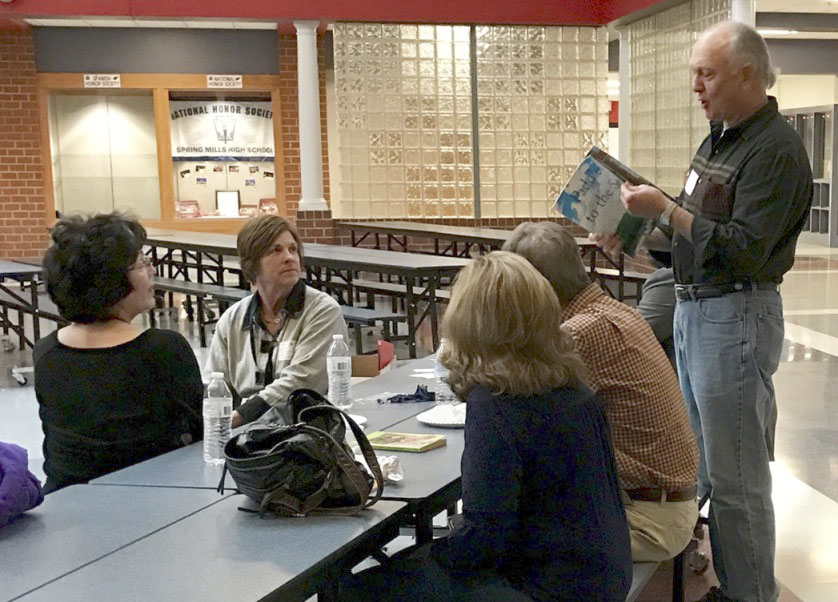 Casey Willson, a Read Aloud Berkeley County board member, shares a favorite children's book with fellow volunteer readers at the Reader Appreciation Social. (Submitted photo)
