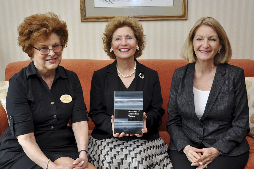 """The """"Anthology of Appalachian Writers: Charles Frazier Volume IX"""" published by Shepherd University is now available. Pictured with the book, from left, are Dr. Sylvia Bailey Shurbutt, professor of English and senior managing editor of the anthology; Shepherd President Mary J.C. Hendrix; and Monica Lingenfelter, executive vice president of the Shepherd University Foundation. (Photo courtesy of Shepherd University)"""