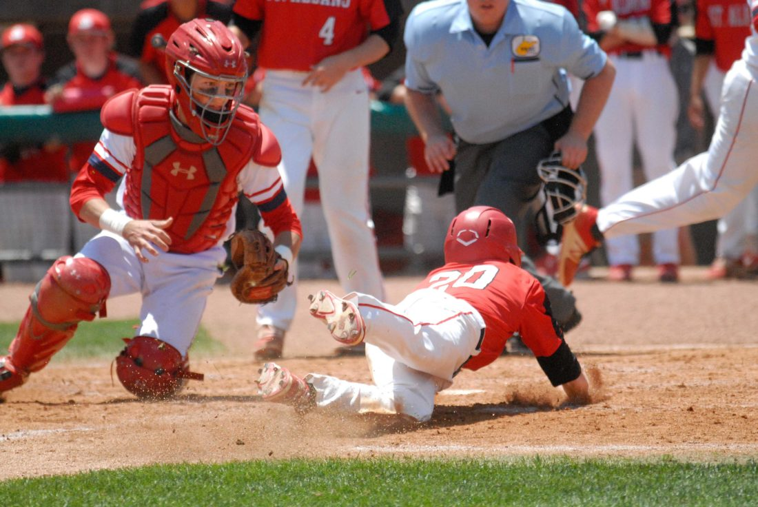 Journal photo by Rick Kozlowski Washington catcher Cameron Pine dives to try and tag St. Albans Tavis Atkins Friday afternoon during the semifinals of the Class AAA state baseball tournament in Charleston.