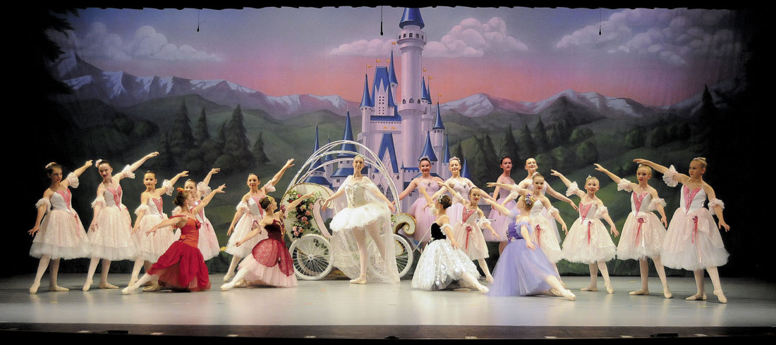 Fairies and Stars bid farewall to Cinderella. Cinderella (Chelsie Sherwood) in front of her carriage. (Journal Photo by Ron Agnir)