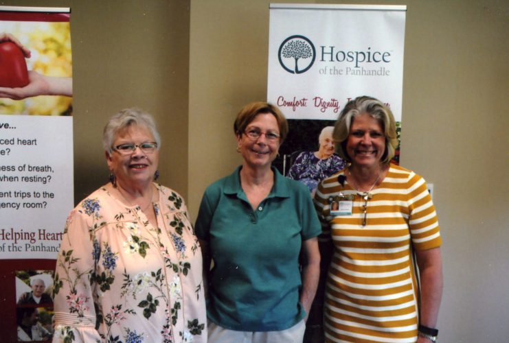Pictured at the May program are Gail Seifert, Robin Truax and Maria Lorensen, discussing Hospice's services. (Submitted photo)