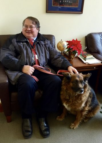Eastern Panhandle Circuit Judge John C. Yoder and his beloved dog pose for a photo.