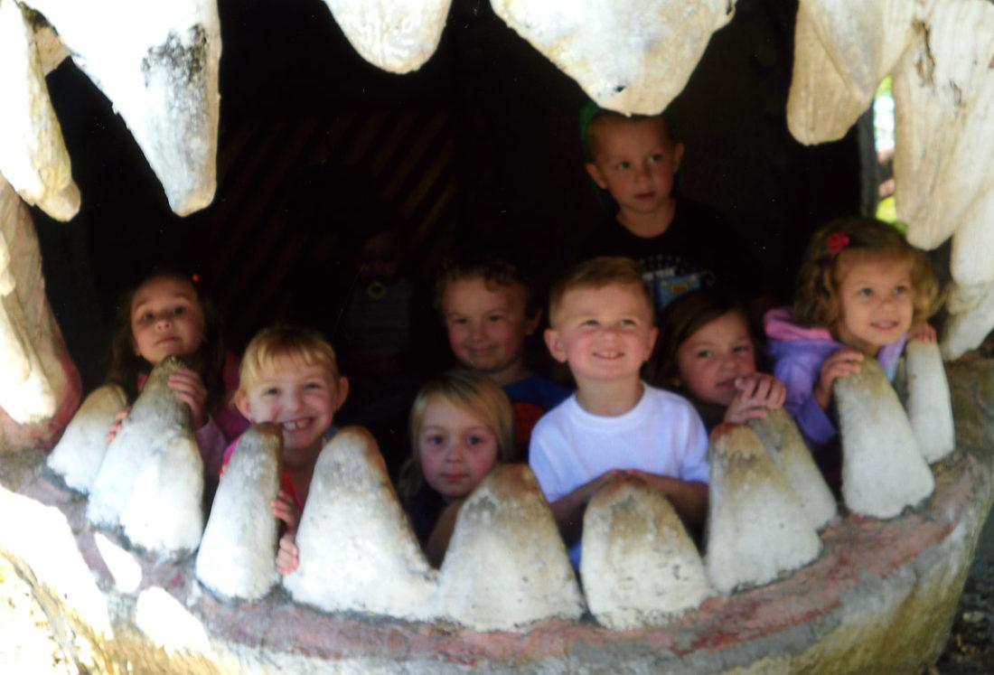 Shown at Dinosaurland, from left, are Sophie Vaughn, Cate Horner, Emma Welton, Hudson Mann, Logan Stanley, Benjamin Duarte, Emma Sherrin and Addie Arvon. (Submitted photo)