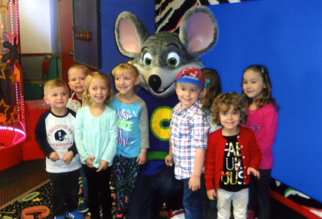 On a trip to Chuck E. Cheese's are, from left, Logan Stanley, Benjamin Duarte, Emma Welton, Cate Horner, Chuck E. Cheese, Hudson Mann, Emma Sherrin (hidden), Addie Arvon and Sophie Vaughn. (Submitted photoO