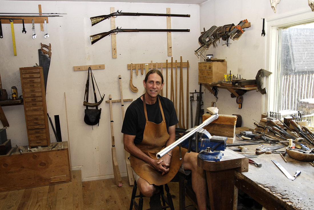 Tim Williams takes a break in his shop where he is building a .58 caliber flintlock rifle. (Journal photo by Jeff McCoy)