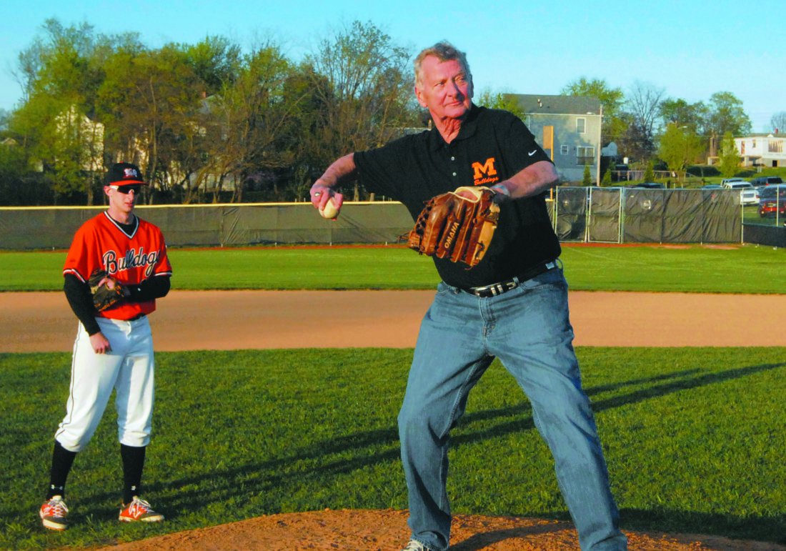 Journal file photo Rick Wachtel throws out a pitch at an event in 2015. Wachtel, the former owner of WRNR, died Thursday after an extended illness.