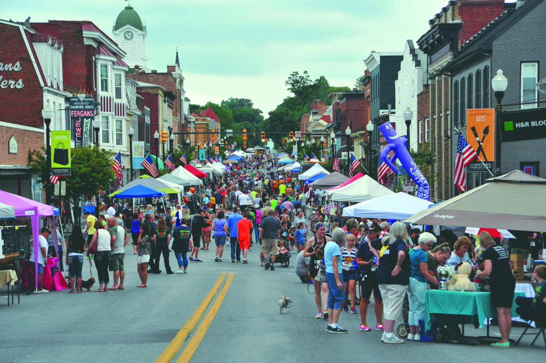 Journal photo by Jeff McCoy Washington Street in Charles Town drew a large crowd for the annual West Virginia Fest.