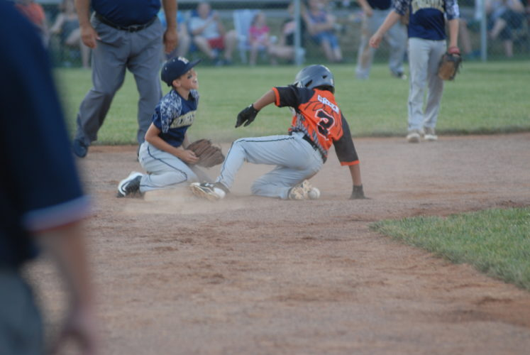 Malakai Green of the Martinsburg Little League 8-10 All-Stats slides in at second base as the ball gets away from Hedgesville's Trenton Knieriem. (Journal photo by Rick Kozlowski)
