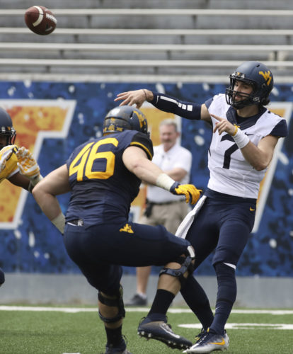 Quarterback Will Grier throws a pass during West Virginia's spring scrimmage in April. He will be eligible this fall.at the start of the season. West Virginia coach Dana Holgorsen confirmed Grier's eligibility Tuesday, June 20, 2017. (AP Photo/Raymond Thompson, File)