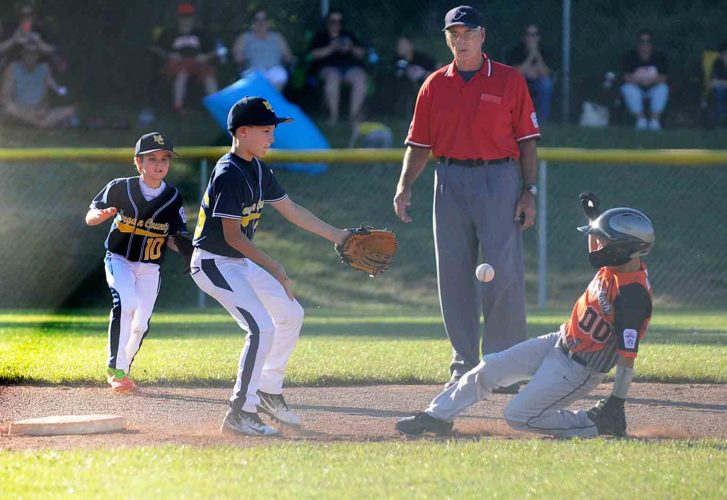 Journal photo by Ron Agnir Morgan County infielders Jaxon McClintoc (10) and Aiden Cain (36) wait for the relay throw as Martinsburg's R.J. Brown steals secnd base during the second inning of the District 6 8-10 Little league tourney Tuesday evening at Oatesdale Park in Martinsburg.  See more photos on CU.journal-news.net.  (Journal photo by Ron Agnir)