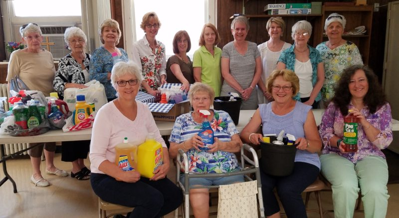 Pictured, along with the many donated supplies for the Catholic Charities mission, are, front row from left, Kathie Campbell, Linda Brining,  Mary Duke, Amanda Lewis; (back row) Nancy Gregory, June Cutlip, Loreena Raines, Deb Myers, Julie Hudson, Rosemarie Day, Jane Clipp, Connie Simmons, Marcia Stickley, and Jean Fulk. (Submitted photo)
