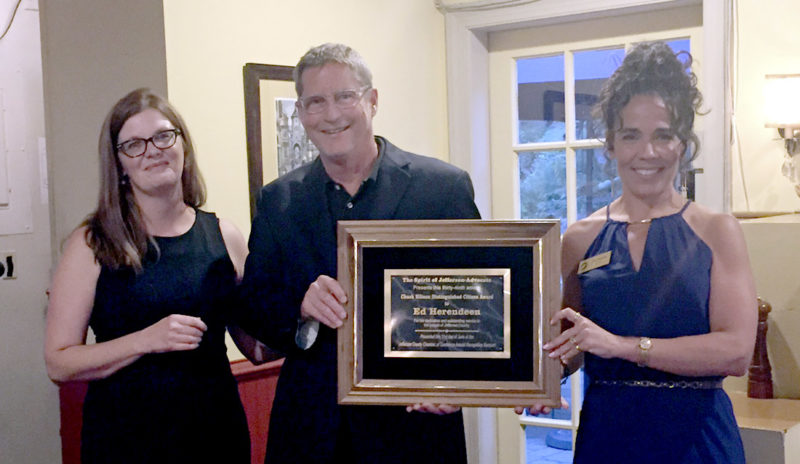 Christine Snyder, managing editor of the Spirit of Jefferson, joins Chamber President Amy Panzarella in presenting Ed Herendeen with the Chuck Ellison Distinguished Citizen of the Year Award. (Submitted photo)
