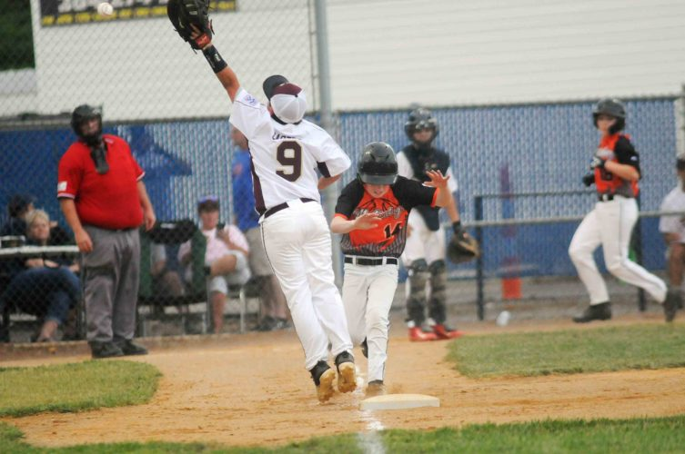 Jefferson's Noah Carter (9) leaps, trying to snag an overthrow that allowed Martinsburg's Ty Dunkin (14) to reach safely as Joseph Paulson (18) scores in the background during the fifth inning of the opening game of the 10-12-year-old Area 1 tournament Friday in Hedgesville  See more photos on CU.journal-news.net.