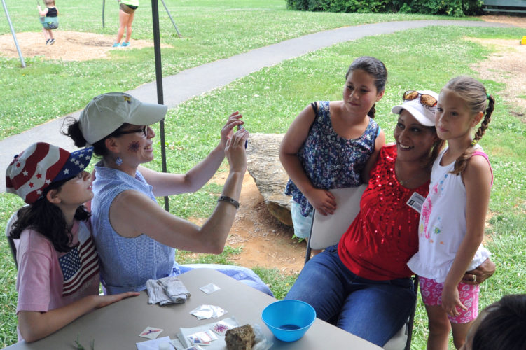 Sen. Patricia Rucker takes a photo of her face painting work on supporters and friends at the Gateway Republican Women second annual Reagan Picnic.